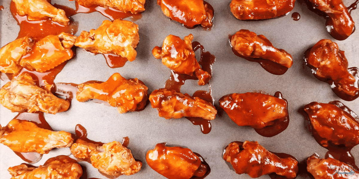 Add your favorite sauce on the chicken wings and they are ready to broil!