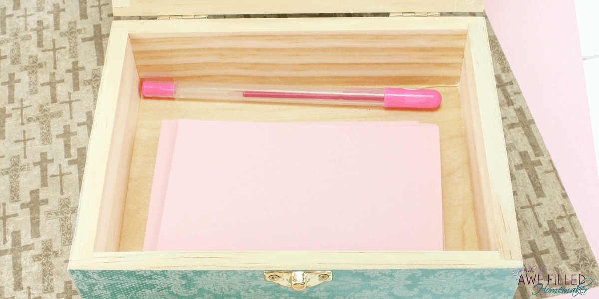 Fill your prayer box with paper and some pens for writing and keeping your prayers.