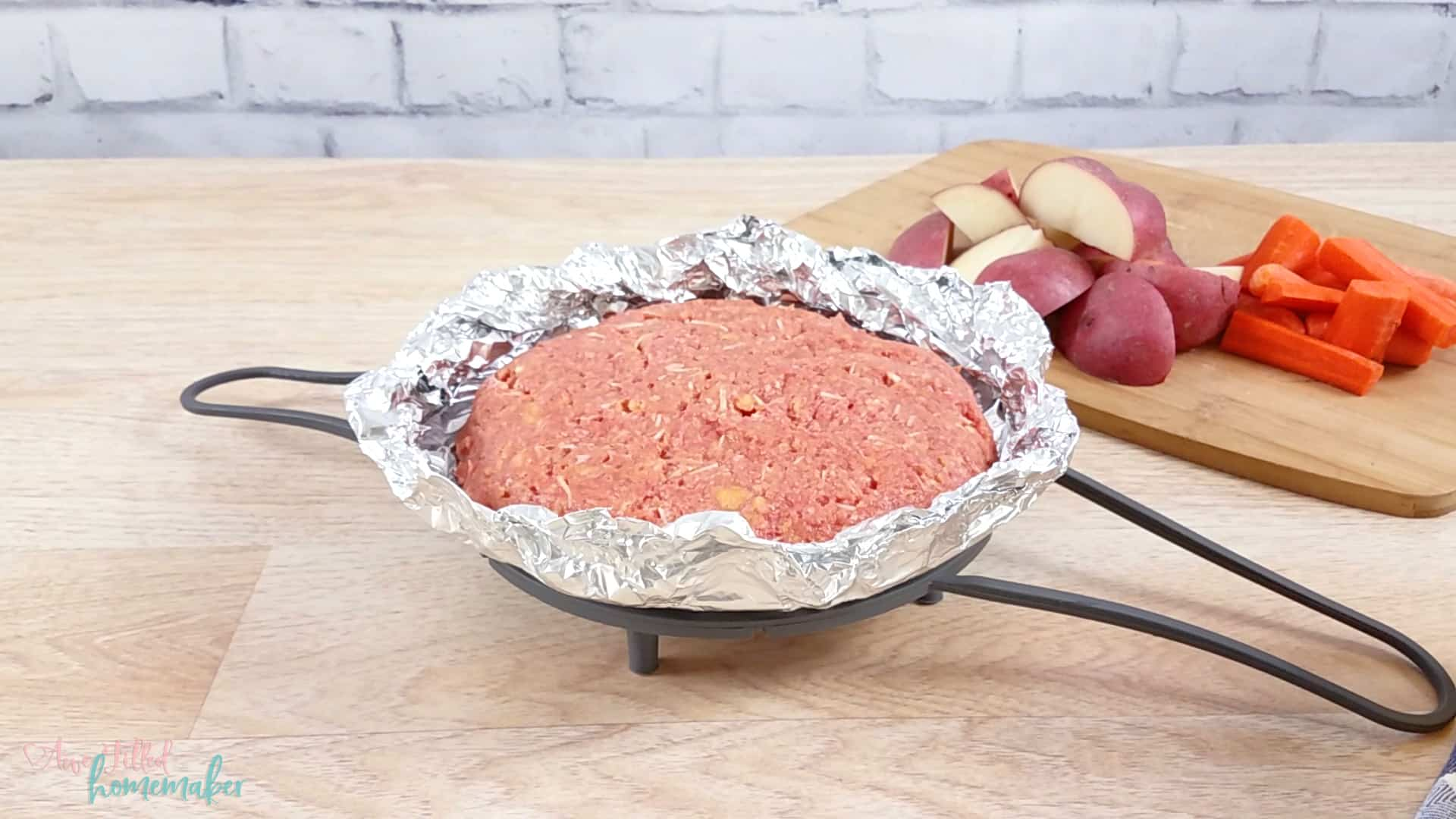 Add meatloaf mixture patty in tinfoil to trivet.