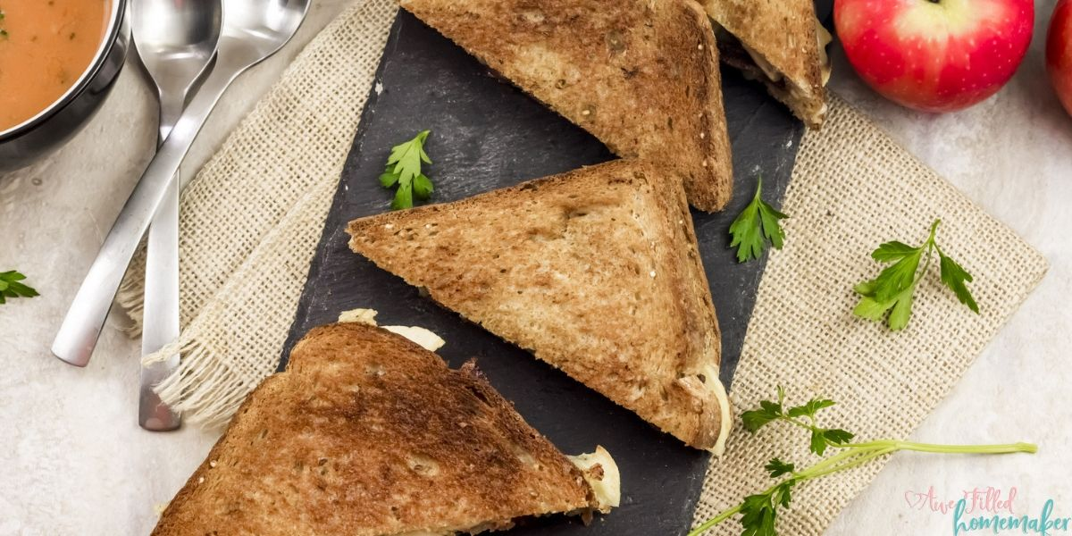 Spice up your lunch by making this Apple Gouda Grilled Cheese sandwich. Upgrade that commonly used American cheese for a delicious and rich gouda, covering slices of sweet apple, bacon, and pickles. All of this sandwiched between perfectly crisped bread to make the ideal sandwich to welcome in Autumn. Although it's delicious year-round, it truly is the perfect Autumn lunch.